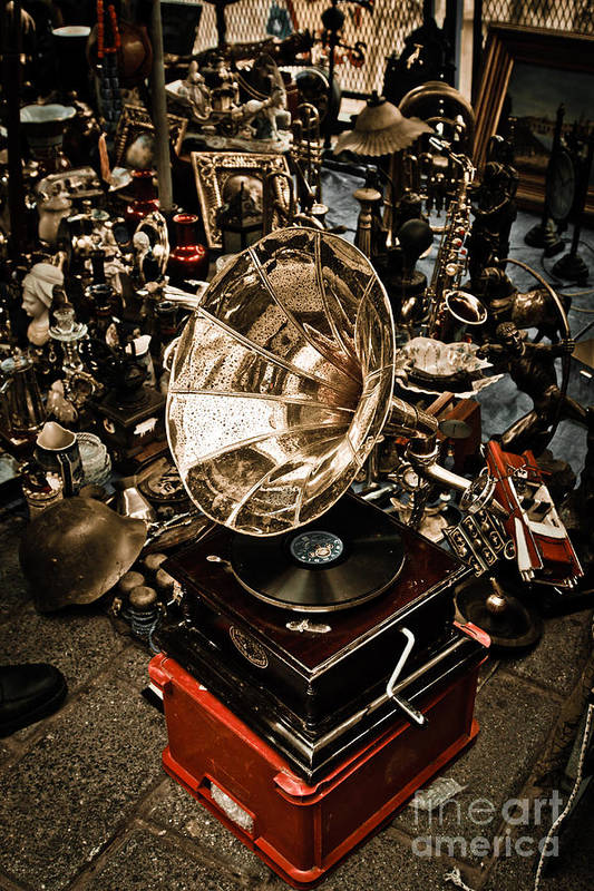 Old; Antique; Vintage; Retro; Background; Style; Art; Decor; Decorating; Decoration; Grunge; Antiquities; Object; Old-fashioned; Classic; Collection; Valuable; Junk; Together; Gathered; Phonograph; Record Player; Gramophone; Sound; Music; Nostalgia; Record; Entertainment; Audio; Box; Player; Speaker; Megaphone; Technology; Equipment; Disc; Design; History; Instrument; Musical; Revival; Print featuring the photograph Gramophone by Gabriela Insuratelu