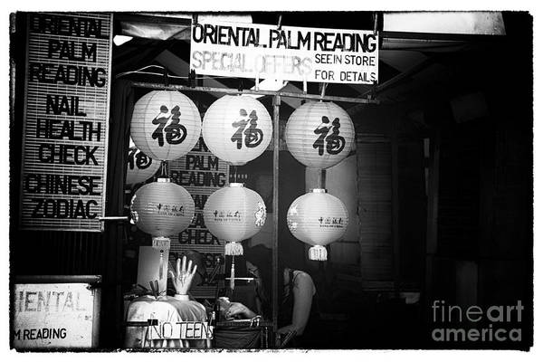 Oriental Palm Reading Print featuring the photograph Oriental Palm Reading by John Rizzuto