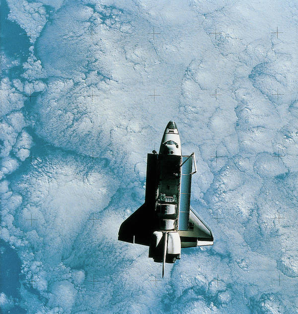 Vertical Print featuring the photograph Space Shuttle Orbiting Above Earth by Stockbyte