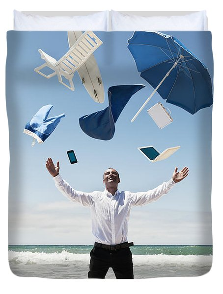 A Man Stands In The Ocean With Items Duvet Cover by Ben Welsh