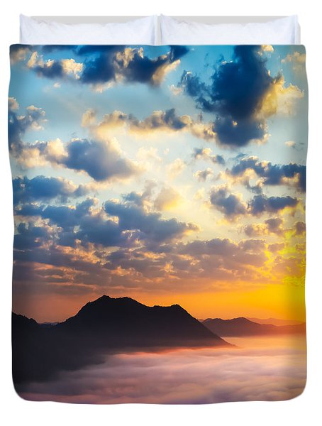 Sea of clouds on sunrise with ray lighting Duvet Cover by Setsiri Silapasuwanchai