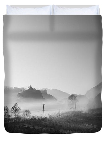 mist in the valley Duvet Cover by Setsiri Silapasuwanchai