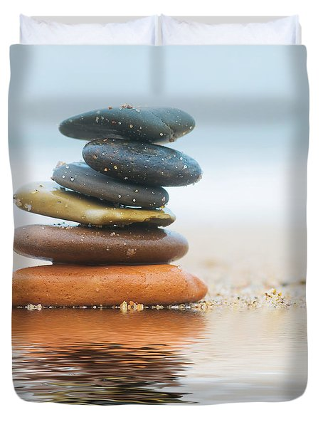 Stack Of Beach Stones On Sand Duvet Cover by Michal Bednarek