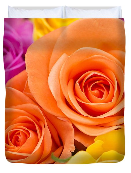 A Riot Of Roses Duvet Cover by Anne Gilbert