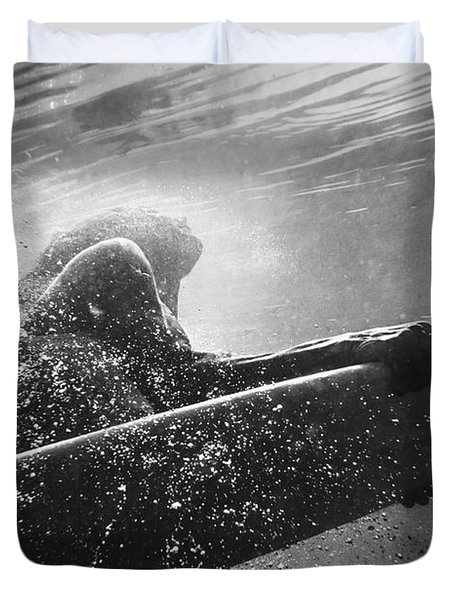 A Woman On A Surfboard Under The Water Duvet Cover by Ben Welsh