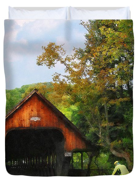 Bicyclist At Middle Bridge Woodstock Vt Duvet Cover by Susan Savad