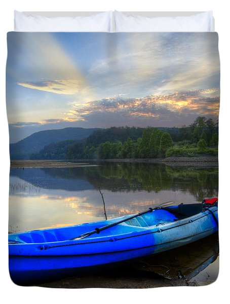 Blue Canoe At Sunset Duvet Cover by Debra and Dave Vanderlaan