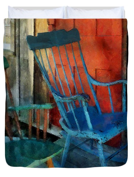 Blue Chair Against Red Door Duvet Cover by Susan Savad