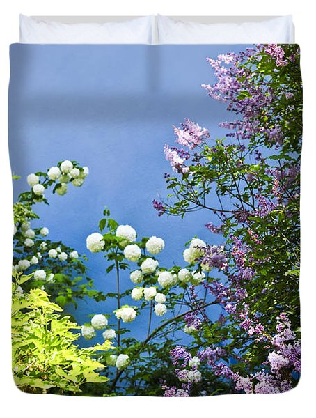 Blue wall with flowers Duvet Cover by Elena Elisseeva