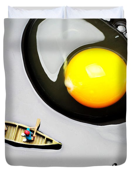 Boating around egg little people on food Duvet Cover by Paul Ge