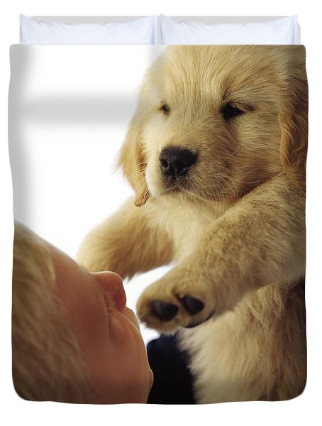 Boy Holding Puppy Up Duvet Cover by Ron Nickel