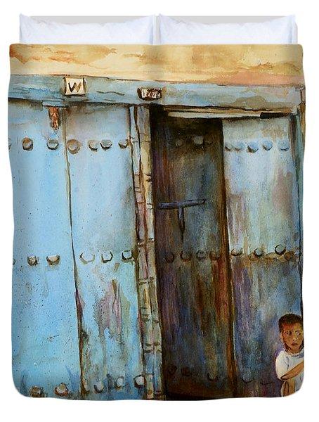 Child Sitting In Old Zanzibar Doorway Duvet Cover by Sher Nasser