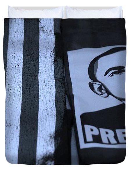 COMMERCIALIZATION OF THE PRESIDENT OF THE UNITED STATES in CYAN Duvet Cover by ROB HANS
