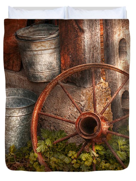 Country - Some dented pails and an old wheel  Duvet Cover by Mike Savad