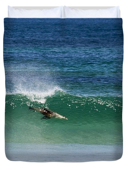 Diving Beneath The Curl Duvet Cover by Mike Dawson