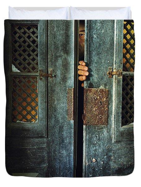Door Peeking Duvet Cover by Carlos Caetano