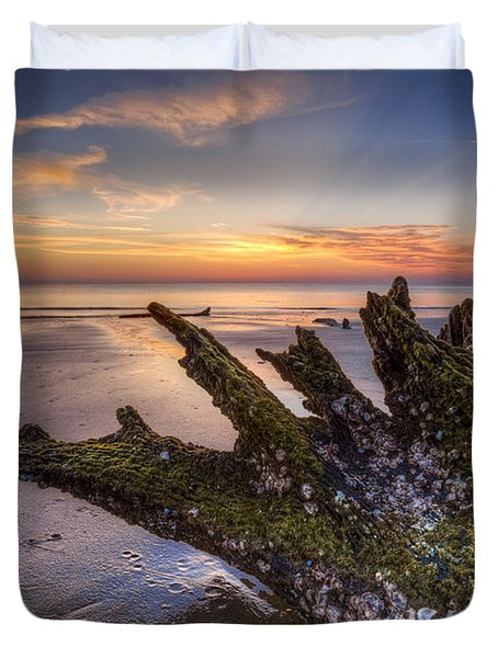 Driftwood On The Beach Duvet Cover by Debra and Dave Vanderlaan