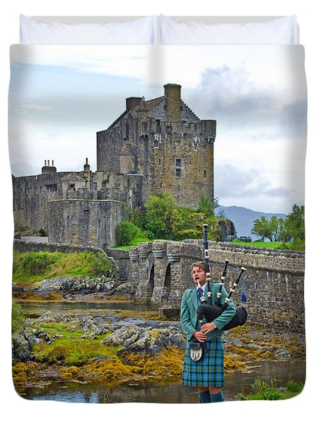 Eilean Donan Castle and the Lone Piper Duvet Cover by Chris Thaxter