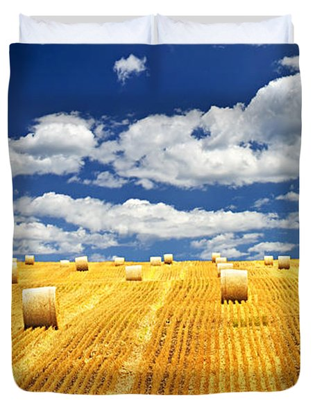 Farm field with hay bales in Saskatchewan Duvet Cover by Elena Elisseeva
