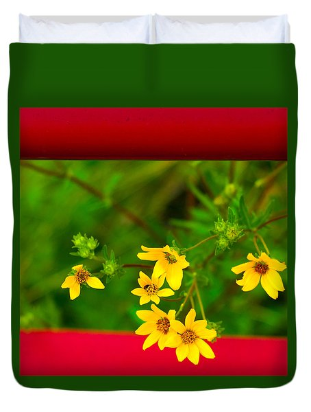Flowers In Red Fence Duvet Cover by Darryl Dalton