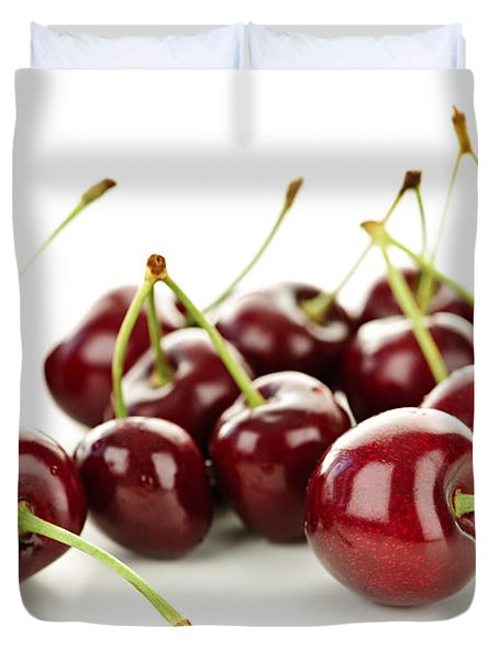 Fresh cherries on white Duvet Cover by Elena Elisseeva