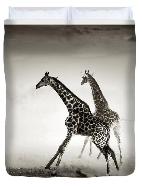 Giraffes Fleeing Duvet Cover by Johan Swanepoel