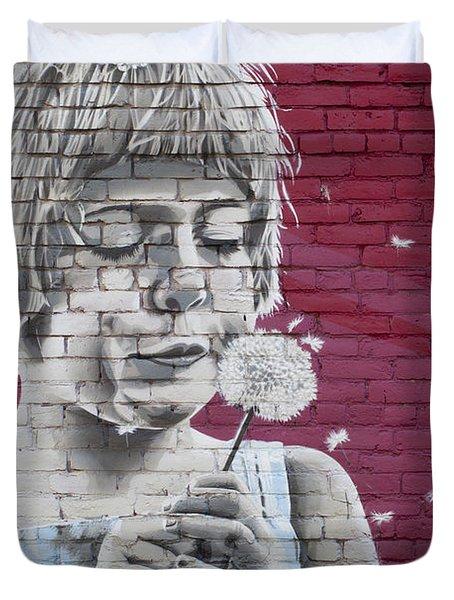Girl Blowing A Dandelion Duvet Cover by Chris Dutton
