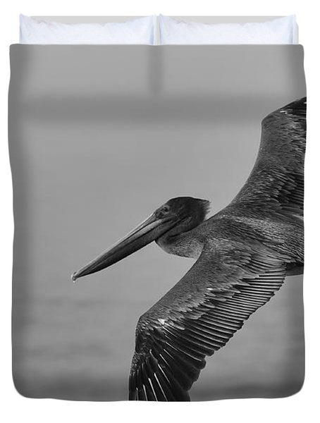 Gliding Pelican In Black And White Duvet Cover by Sebastian Musial