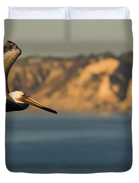 Gliding Pelican Duvet Cover by Sebastian Musial