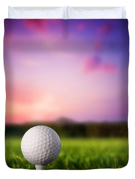 Golf ball on tee at sunset Duvet Cover by Michal Bednarek
