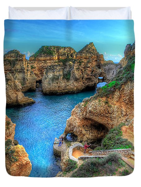 Grottos At Ponta Piedade Duvet Cover by English Landscapes