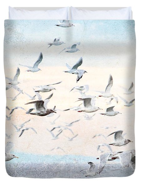 Gulls Flying Over The Ocean Duvet Cover by Peggy Collins