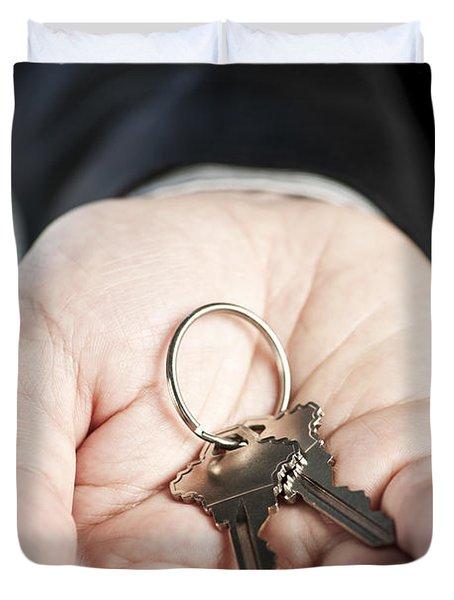Hand Offering New Keys Duvet Cover by Elena Elisseeva