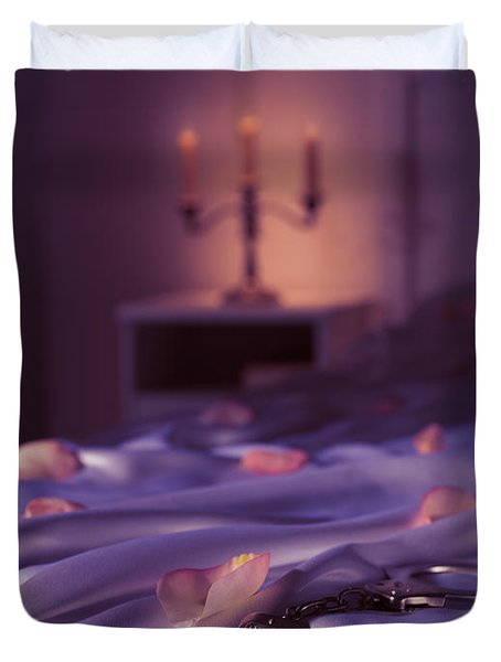 Handcuffs And Rose Petals On Bed Duvet Cover by Oleksiy Maksymenko