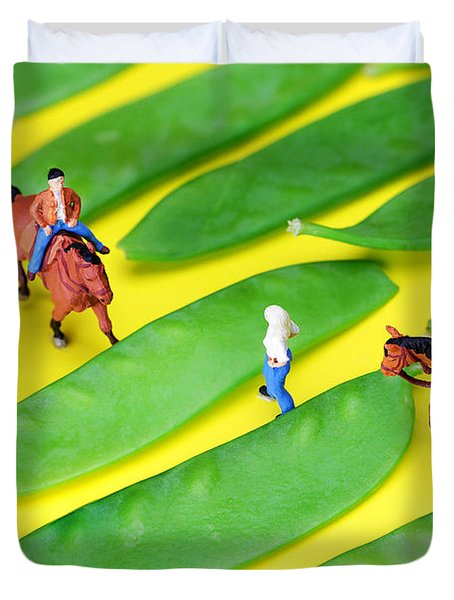 Horse riding on snow peas little people on food Duvet Cover by Paul Ge