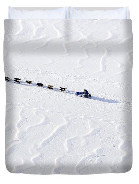 John Bakers Team Running Down Frozen Yukon River  Duvet Cover by Jeff Schultz