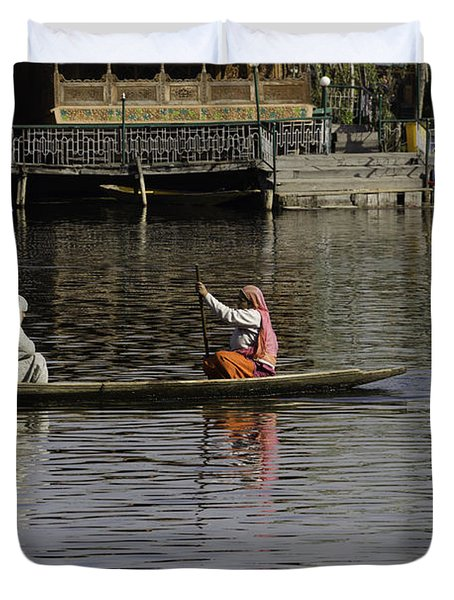 Ladies plying a small boat in the Dal Lake in Srinagar - in fron Duvet Cover by Ashish Agarwal