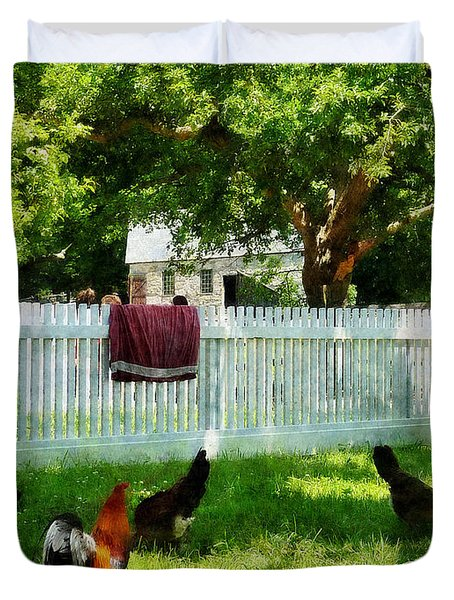 Laundry Hanging On Fence Duvet Cover by Susan Savad