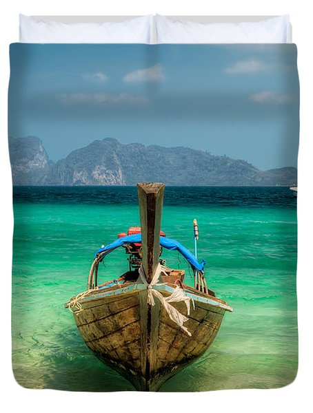 Moored Longboat Duvet Cover by Adrian Evans