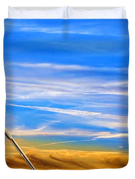 Mountaineer Statue With Blue Gold Sky Duvet Cover by Dan Friend