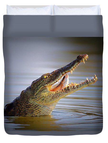 Nile Crocodile Swollowing Fish Duvet Cover by Johan Swanepoel