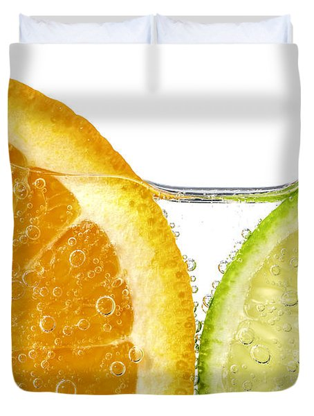 Orange and lime slices in water Duvet Cover by Elena Elisseeva
