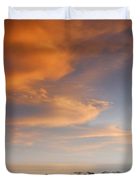 Orange sunset at the rocks Duvet Cover by Guido Montanes Castillo