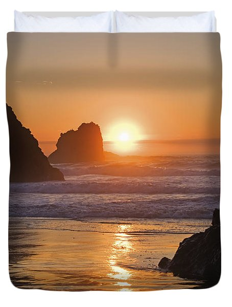 Orange Sunset Behind Offshore Rocks Duvet Cover by Philippe Widling