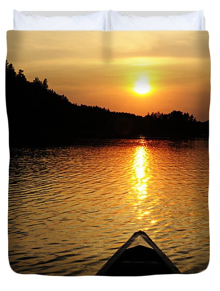 Paddling Off Into The Sunset Duvet Cover by Larry Ricker