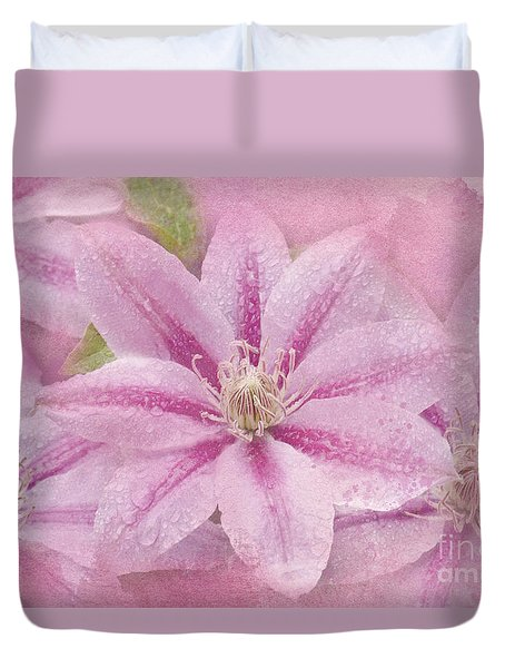 Pink Clematis Profusion Duvet Cover by Betty LaRue