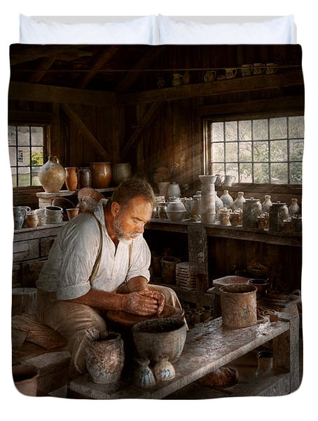 Potter - Raised in the clay Duvet Cover by Mike Savad