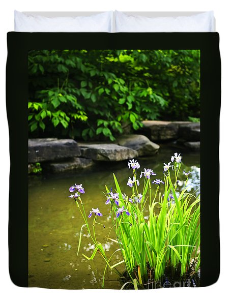 Purple Irises In Pond Duvet Cover by Elena Elisseeva