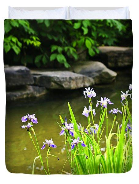 Purple irises in pond Duvet Cover by Elena Elisseeva
