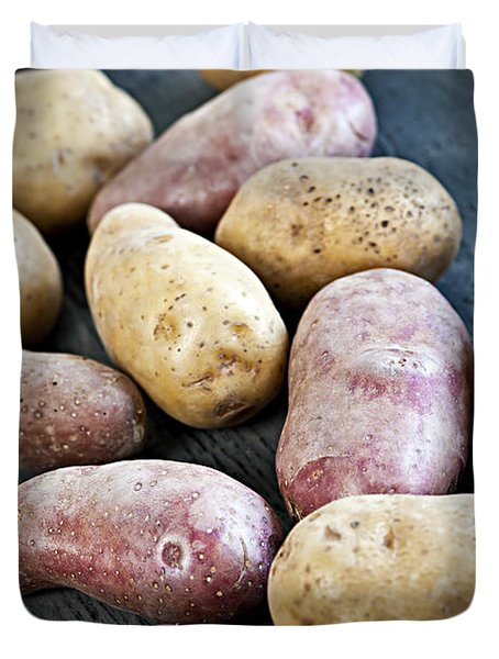 Raw potatoes Duvet Cover by Elena Elisseeva